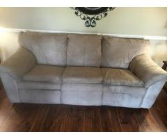 Tan/khaki microfiber reclining sofa and loveseat