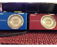 Two Nikon Coolpix S570 cameras.